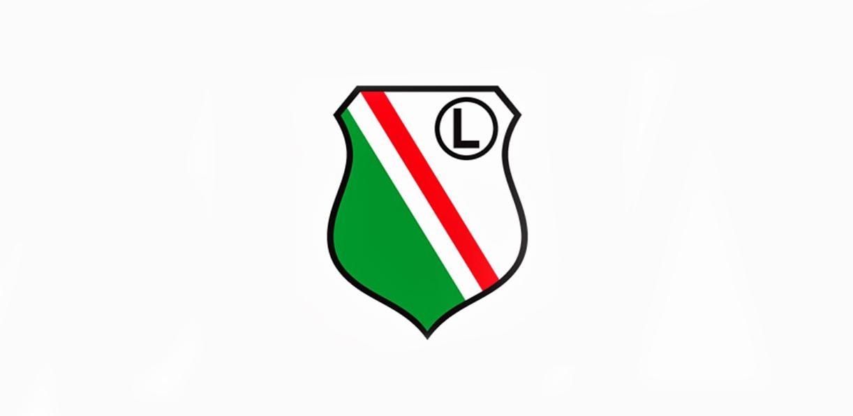 Ilustracja przedstawia znak legii, tarczę z zielonym i czerwonym paskiem, oraz literę L w prawym górnym rogu tarczy.