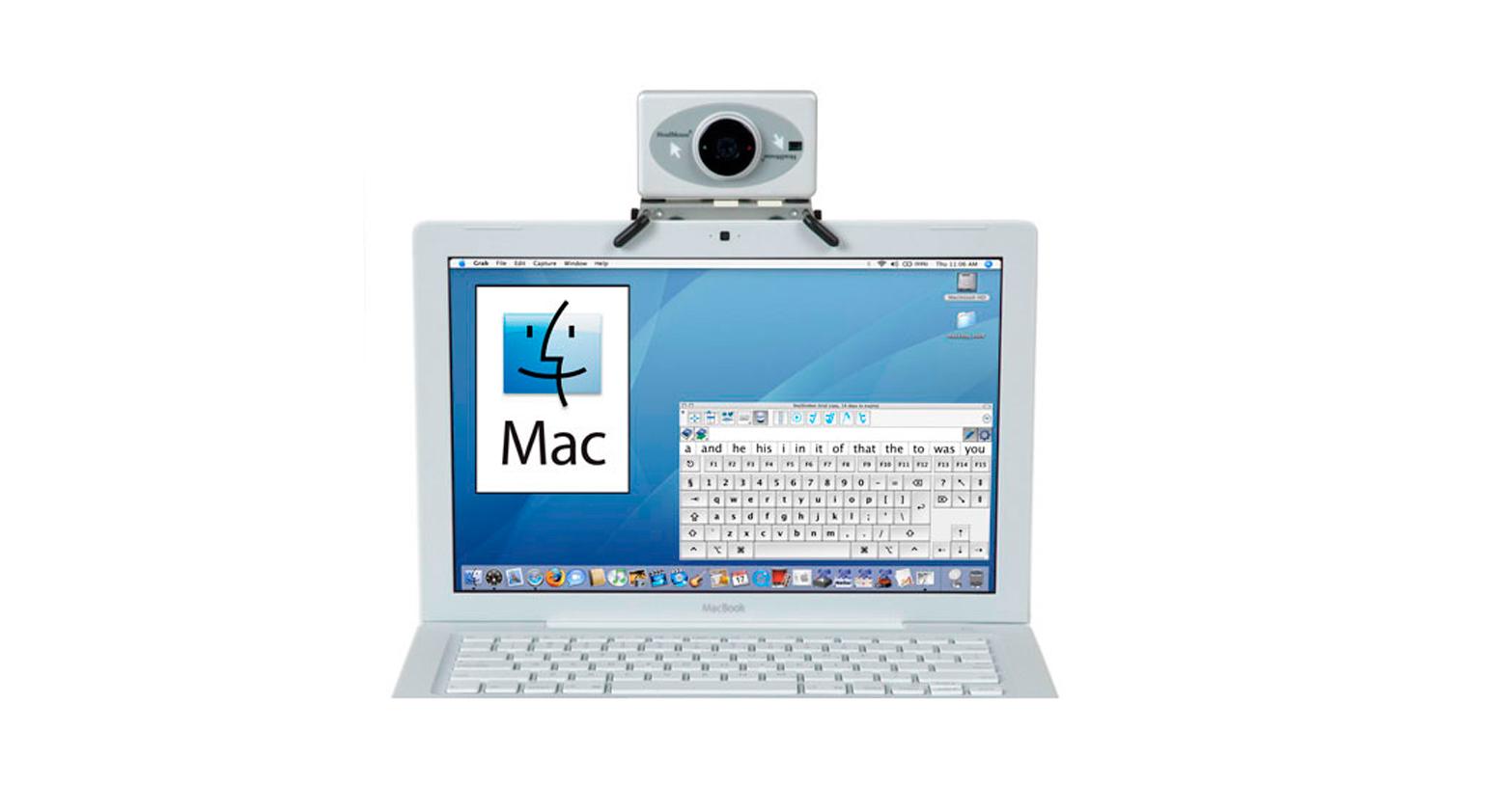 Zdjęcie przedstawia laptop, na który nałożona jest myszka. Jest przymocowana u góry monitora na środku, ma prostokątny kształt i mały, okrągły obiektyw.