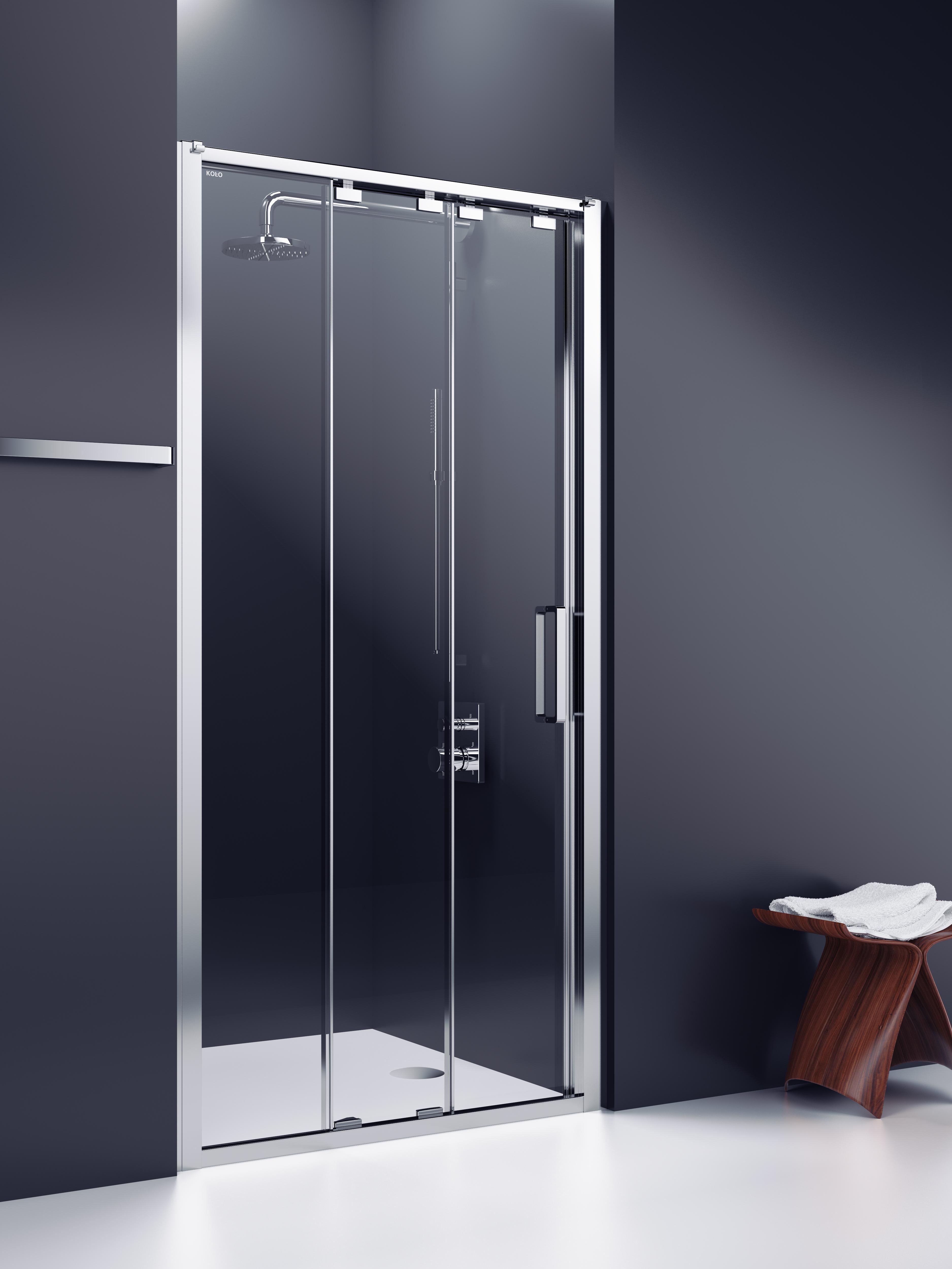 Zdjęcie przestawia wbudowaną kabinę koło ultra, zastosowaną w minimalistycznej, łazience, w kolorach grafitu i bieli.