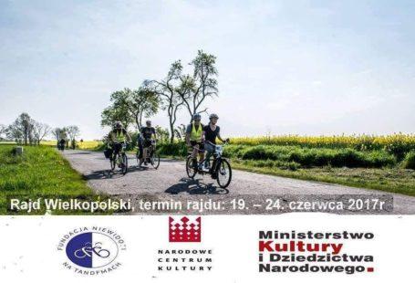plakat promujący rajd wielkopolski, termin rajdu 19-24 czerwca, jest na nim zdjęcie ludzi jadących na tandemie, oraz rowerach, oraz podpisy